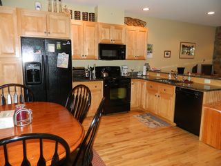 Carrabassett Valley condo photo - View of the fully stocked kitchen. Beautiful hard wood floors.