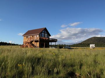 Grand Canyon house rental - Surrounded by elk grass and open space and facing a glorious mountain view.