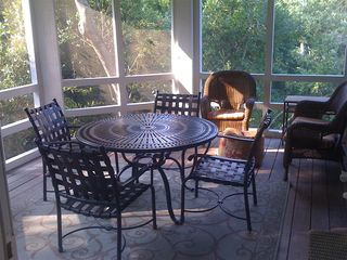 Bald Head Island house photo - Filtered sunlight brightens the screen porch.