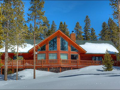 The Lovely Exterior View Surrounded by Snow Capped Trees