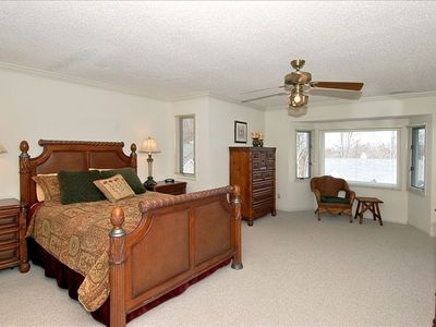 The Master Bedroom Features a Beautiful Queen Bed and a Large Master Bath