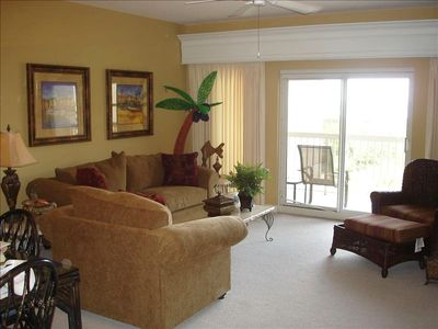 Spacious Living Area with view of ocean and tennis courts.New Carpet.