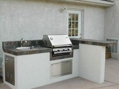 Outdoor Kitchen by pool & fire pit