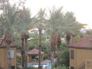 Scottsdale condo photo - View of pool from front balcony with golf course in background