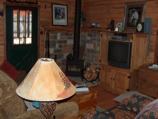 Pagosa Springs cabin photo - TV and wood stove