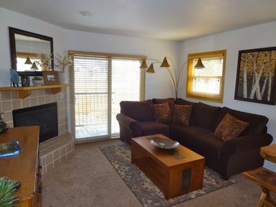 Frisco townhome rental - Den area with gas fireplace -- flat panel TV is on the wall opposite the couch