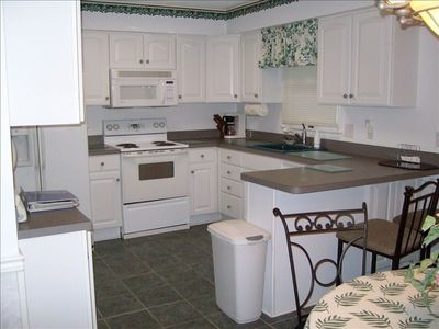 REMODELED KITCHEN WITH CERAMIC TILE FLOOR