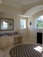 Port St. Lucie house photo - Master Bathroom. His and Hers sinks/vanity on opposing sides of room