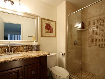 1st Bathroom. Walk-in Shower with Natural Stone Tile And Granite Counter Top