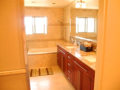 marble, travertine, 10 shower heads, cherrywood and more in the master!