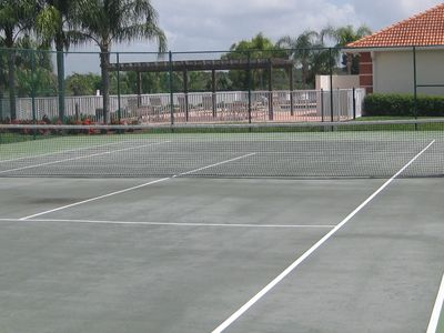 Private tennis court next to club house.