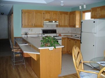 Kitchen With Oak Cupboards, Ceramic Floors, Dishwasher & Breakfast Bar!