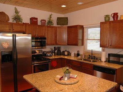 Ultra modern kitchen with many amenities.