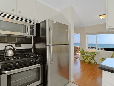 Kitchen with stainless steel appliances with ocean views