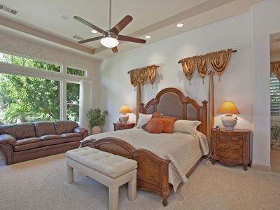 Master bedroom suite with sitting area & view of backyard/golf course/mountains