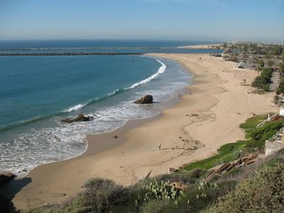 Corona del Mar State Beach with parking, fire pits, restaurant, minutes away