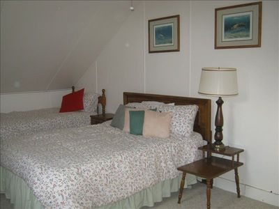Double and twin in this sunny upstairs bedroom