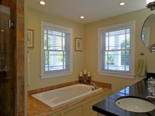 Key West house photo - The raised bathtub is a real luxury, set next to a glass shower with seat.