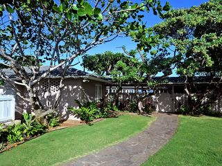 Kailua house photo - Large gated grassy front yard with tropical landscaping