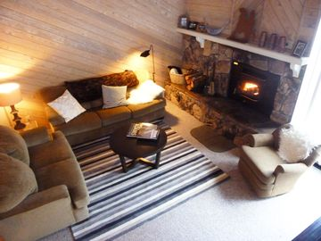 Mammoth Lakes condo rental - Living area as seen from 3rd story loft. Wood stove, tv not shown has Direct TV.