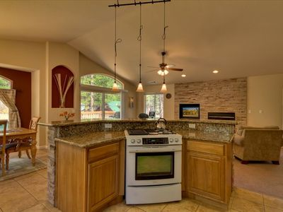Separate island in kitchen with gas stove and integrated grill