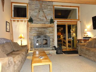 Jay Peak condo photo - 14'Natural Stone Hearth, Wood Fire, Grampa Tony's Skis, Grampa Nick's Snowshoes