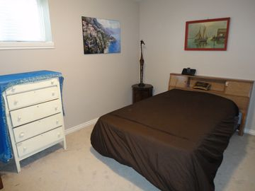 Calgary Vacation Home downstairs double bed with dresser, closet and TV