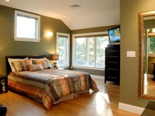 Bath house photo - Bedroom with large water views & flat screen TV