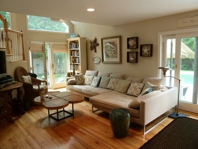Spacious Family Room has french doors to pool & patios.