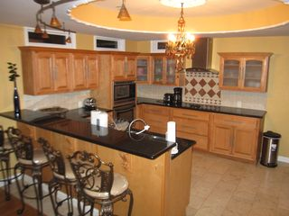 Conyers house photo - Gormet Kitchen with Granite coutertop, Stainless Steel Appliances & Breafast Bar