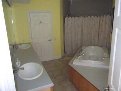 2nd Floor Large Master Bathroom with double sinks, Jacuzzi tub, 7 ft shower