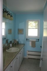 Hillman house photo - Main floor bathroom with tub and shower.