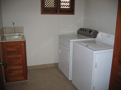 Full laundry room with sink, linen closet and all towels