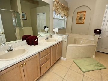 Master Bath with walk-in closet, shower and soaking tub