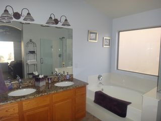 Goodyear bungalow photo - Master bath with soaker tub, separate lavatory room and walk-in closet.