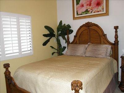 Master Bedroom with AC, flat screen TV  and view of Haleakala and tennis courts.