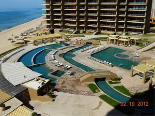Puerto Penasco condo photo - View of the pools, swim up bar, spas and lazy river.