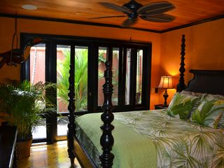 Tamarindo house photo - Queen Bed in Master Bedroom with french doors opening into lush gardens
