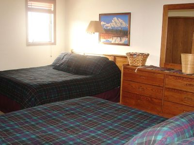 Two comfortable queen size beds face Keystone Mountain.