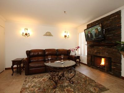 Palm Desert condo rental - Living Room with Wood Fireplace. Brand New Leather Recliner Couch and Chair
