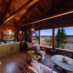 Large open main room with a beautiful shoreline view.