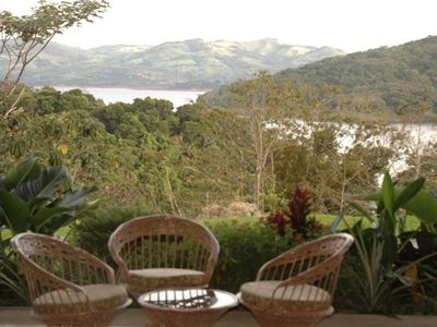Admire our view from the living room, over the porch to Lake Arenal beyond.