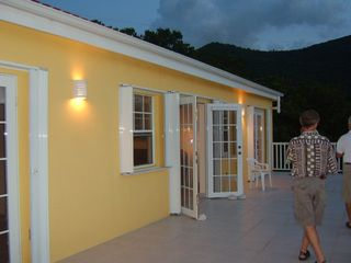 St. Croix house photo - Three sets of french doors open out onto a 46 foot long deck. Amazing sunsets!