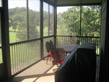 Large screened in porch overlooking 13th fairway. Comes with large gas grill.