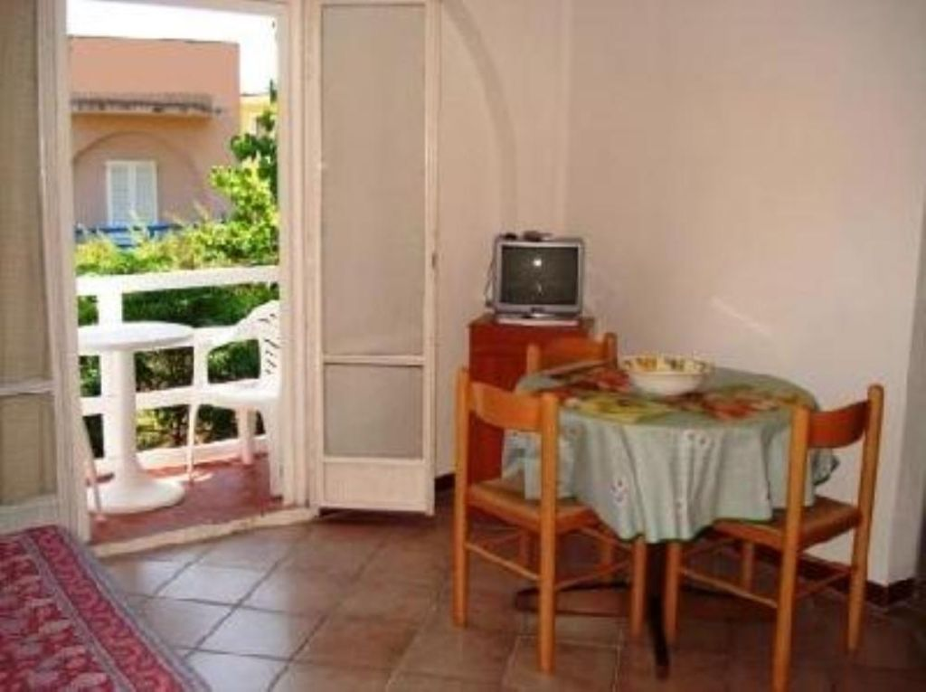 flat up to 4 people living room with dining area and furnished balcony balcony furnished small