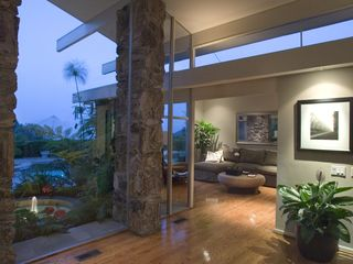 Hollywood estate photo - Atrium w/ 12' Walls of Glass leading to Dem/Medai rm