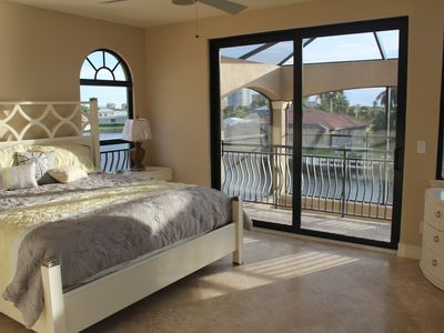 Bedroom 4 - sliders to top deck - corner window for panoramic views of lagoon.