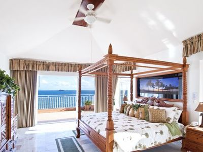 Master suite, king bed, flat screen TV, Balcony leads to pool.