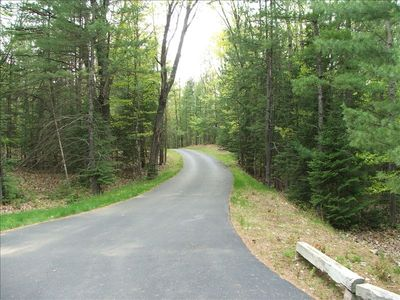 Private tree lined driveway with direct access to snowmobile trail