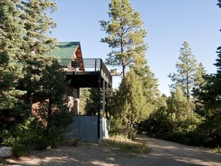 Taos house photo - The north elevation of the house with the master suite and sunset view deck